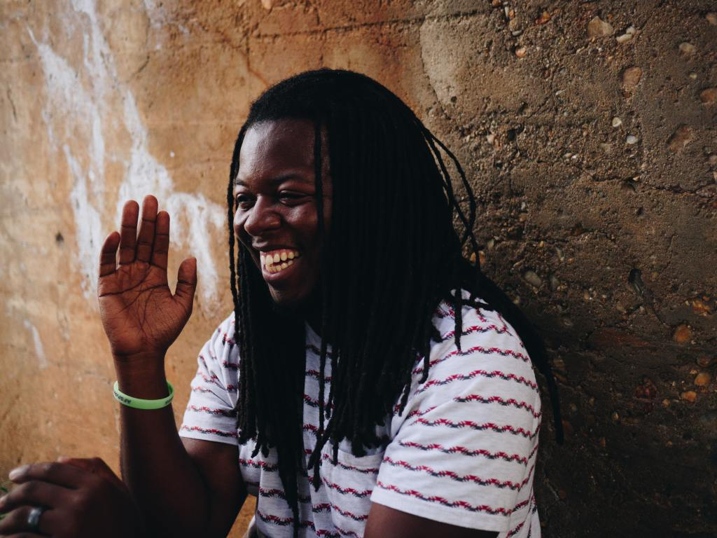 laughing man with locs